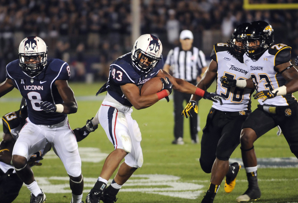 Connecticut running back Lyle McCombs carries the ball in the second quarter against Towson at Rentschler Field in East Hartford, Connecticut, on Thursday, August 29, 2013. Towson won, 33-18. STEPHEN DUNN/sdunn@courant.com