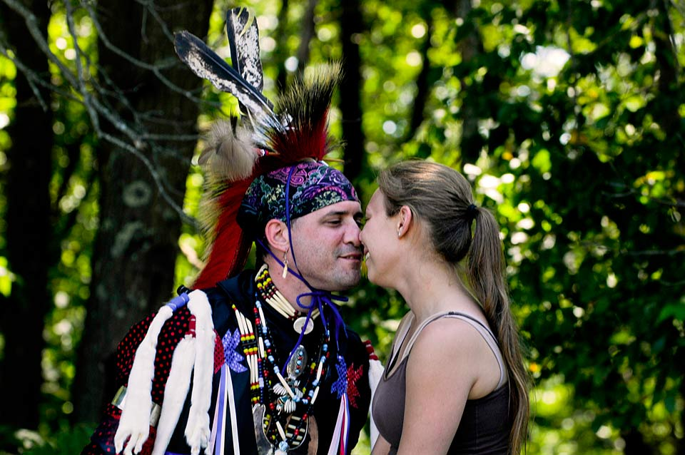 Tommy Ninigret Harris, 31, and his girlfriend Christina Strano, 26, exchange a nose kiss just before Harris competes in the men's northern traditional dance category at the Feast of Green Corn & Dance at the Mashantucket Cultural Grounds. Harris says both he and Strano are descendents of the Nipmuc tribe.