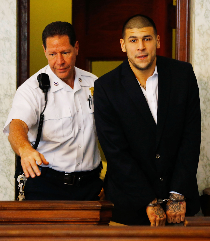 Aaron Hernandez, who has been indicted on a first-degree murder charge for the death of Odin Lloyd, is escorted into is escorted into the courtroom. (Photo by Jared Wickerham/Getty Images)