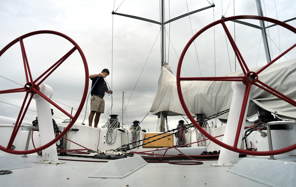 Kit Will, Sailing Director for Pilots Point Marina in Westbrook, straightens up lines aboard Stars & Stripes.