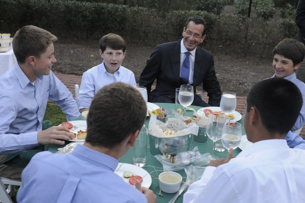Governor Dannel Malloy smiles as he sits with members of the Westport Little League team at his home in Hartford. Seated with him are from left, Harry Azadian, Drew Rogers and Alex Reiner. Not facing the camera from left are Harry Azadian, and Tatin Llamas.