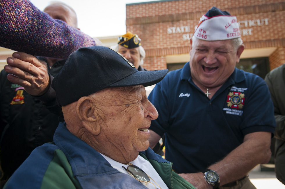 2013.09.17 - Hartford, CT - 90-year-old World War II Veteran Andy Nowicki (middle) celebrates with veteran Rusty Meek after it was decided in Hartford Housing Court that Newington's Housing Authority would not evict Nowicki and his 90-year-old wife, Leona, from their senior housing apartment in Cedar Village for smoking too close to his building. Photograph by Mark Mirko | mmirko@courant.com