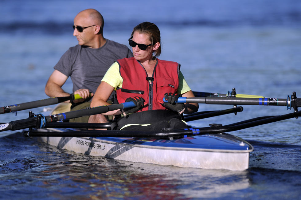 Shellie Cyr of Granby, who lost the use of her legs in an auto accident, gets a rowing workout in a two-man shell with her volunteer partner, Layth Haddad of Granby during a recent session on the Conn. River.