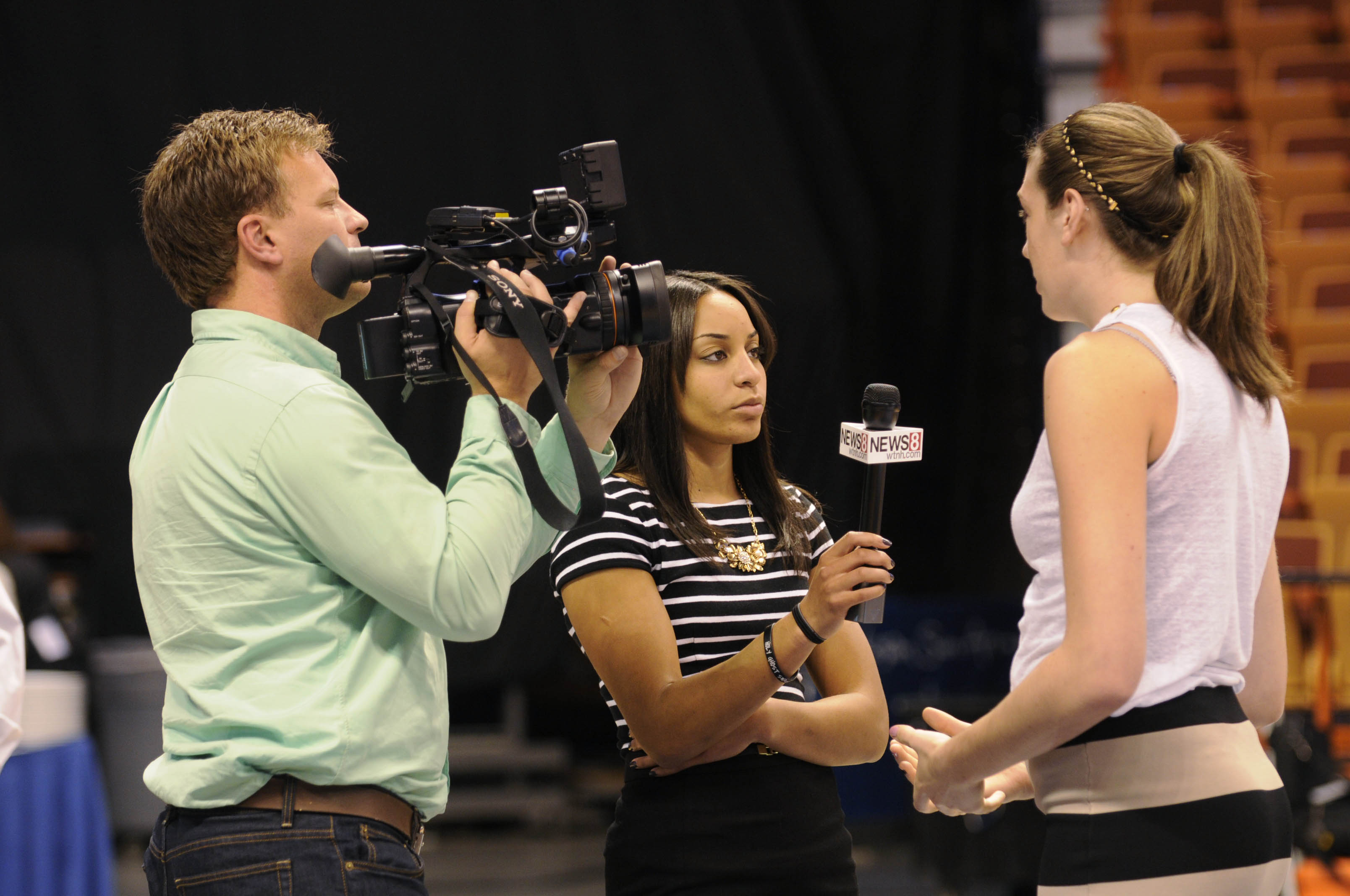 UNCASVILLE 10/14/13 UConn's Bria Hartley (center) helps WTNH's John Pierson (left) with an interview with UConn's Breanna Stewart (right) at the American Athletic Conference media day at the Mohegan Sun Arena Monday.  Stewart was selected as the Preseason Player of the Year.  CLOE POISSON|cpoisson@courant.com