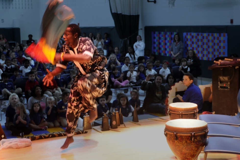 Abdou Sarr, originally from Senegal, and now living in Mass, performs a dance during the concert to music played by Tony Vacca.