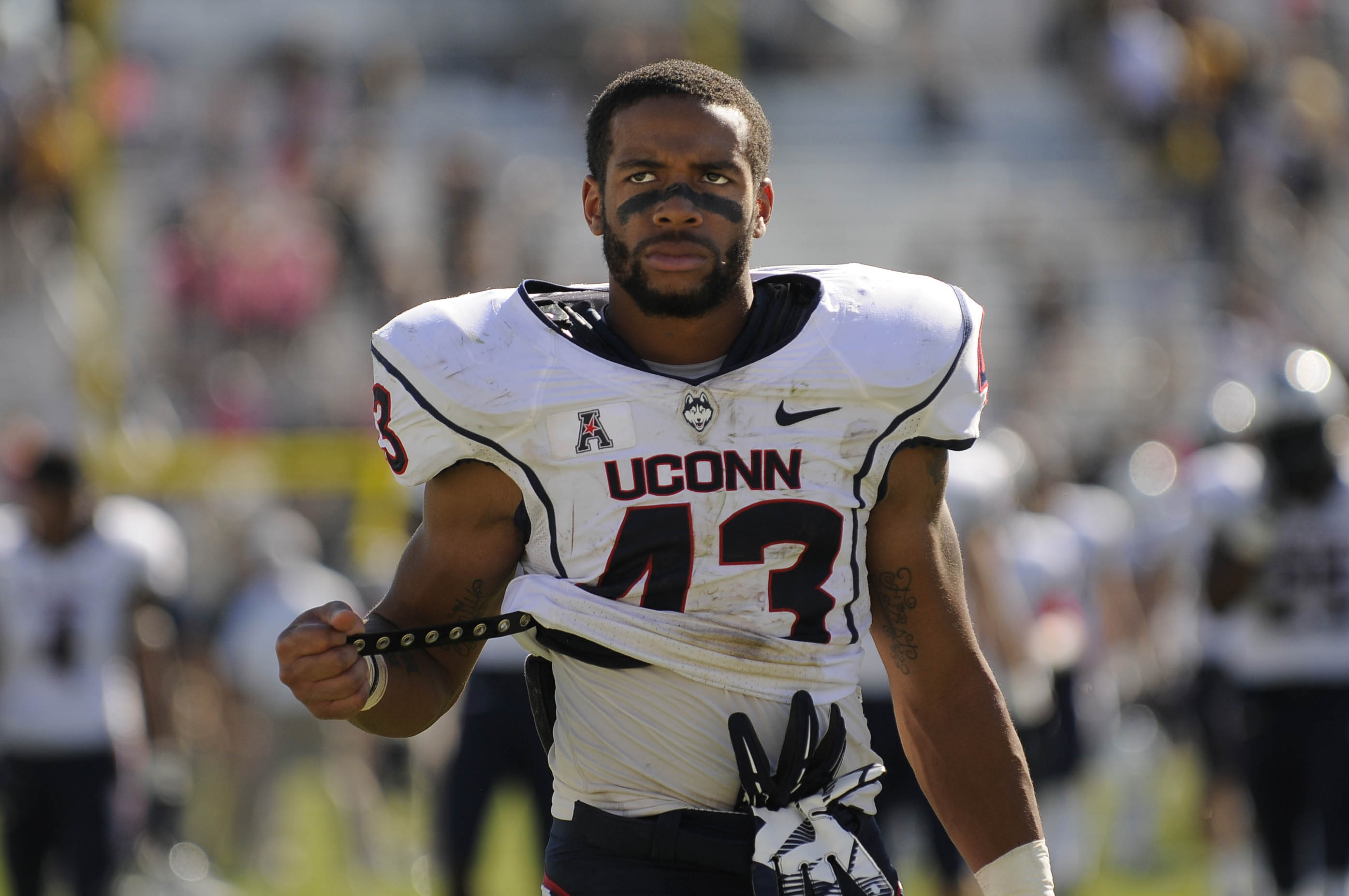 ORLANDO 10/26/13 UConn running back Lyle McCombs (43) looks grim as he leaves the field after UConn took a drubbing by UCF at Bright House Networks Stadium, losing 62-17 Saturday. CLOE POISSON|cpoisson@courant.com