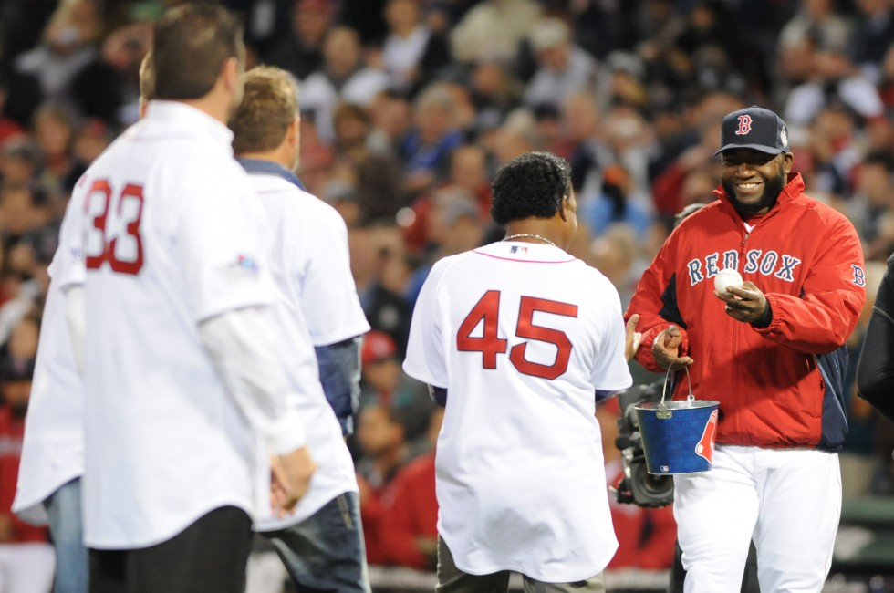 Boston Red Sox designated hitter David Ortiz, 34, hands out balls to fellow members of the 2004 World Series Champion Red Sox, on the pitchers mound before the game so they could all throw out the first pitch.