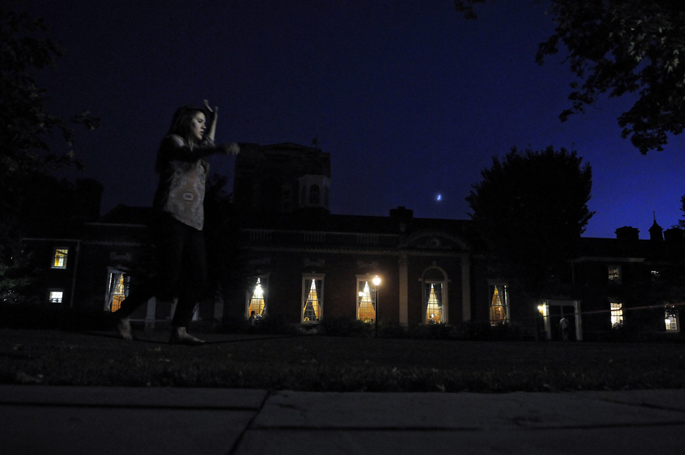 Caroline Smith, of Lexington, Ky, practices her slacklining between two trees in the Davenport College courtyard at Yale as a sliver of the moon rises Tuesday evening. Smith is a senior majoring in psychology and finds this form of exercise is very relaxing, similar to yoga requiring balance and calmness.