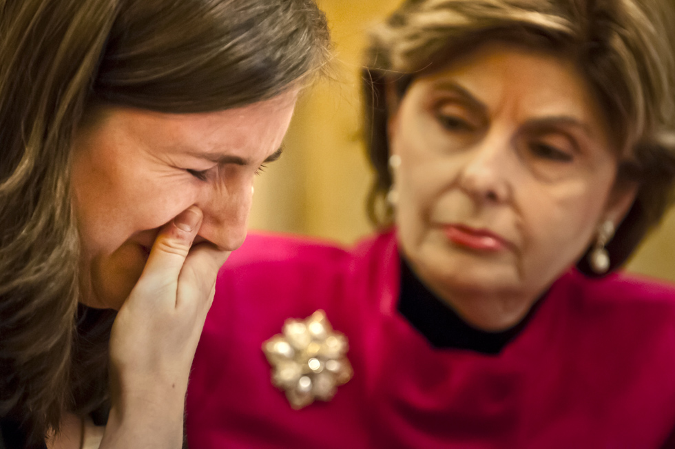 2013.10.21 - Hartford, CT - Accompanied by attorney Gloria Allred (R), University of Connecticut graduate Kylie Angell cries during a press conference while talking about being raped by a classmate. Angell, is one of seven current and/or former University of Connecticut students represented by Allred who has filed a complaint with the Office of Civil Rights claiming the students' rights under Title IX have been violated by UConn. Photograph by Mark Mirko | mmirko@courant.com
