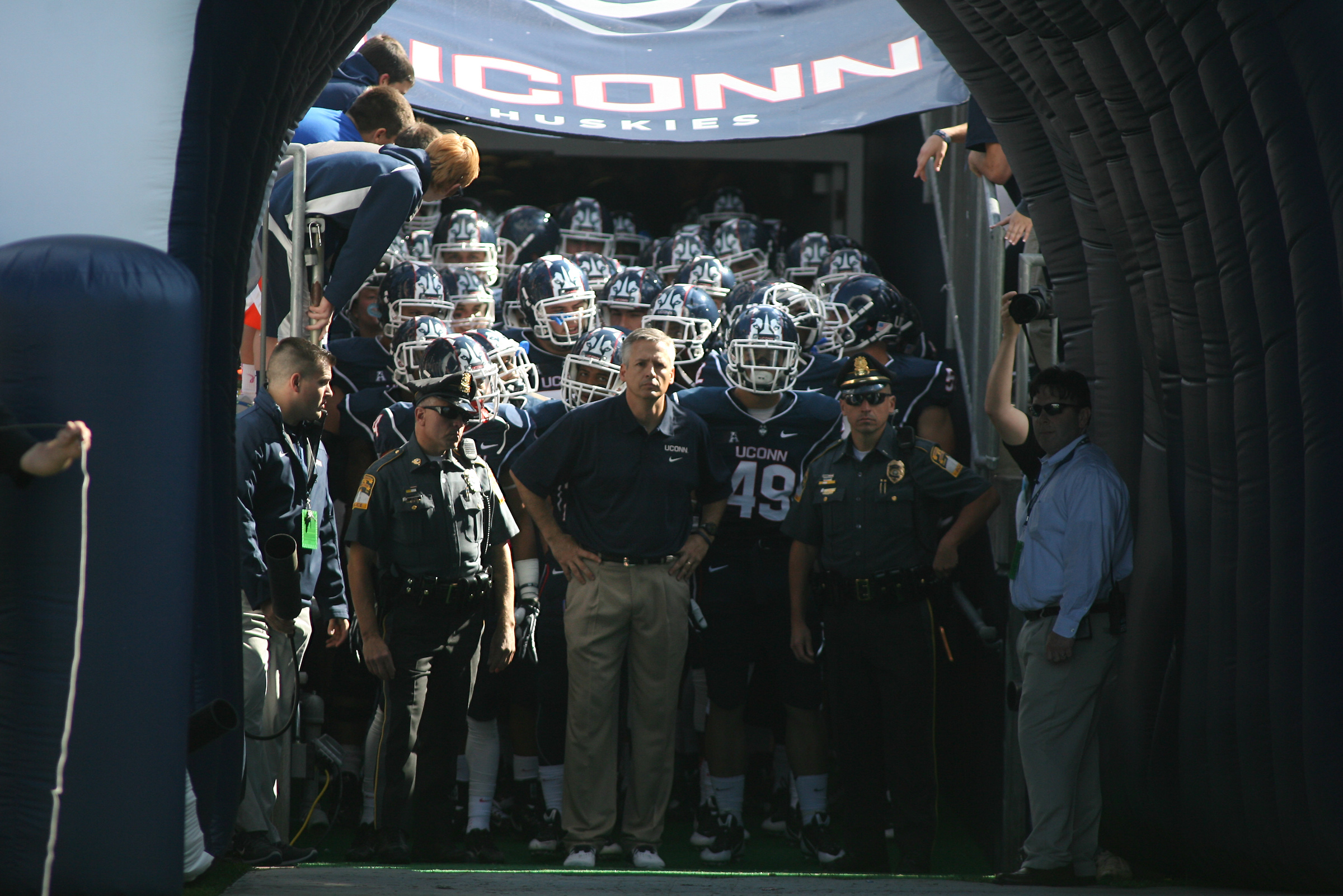 UConn's T.J. Weist waits to take the field with his team for his first game as interim Head Coach.