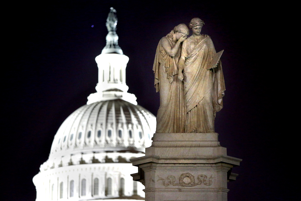 Statues of female figures representing Grief and History stand before the U.S. Capitol Dome, October 1, 2013. The U.S. government began a partial shutdown on Tuesday for the first time in 17 years, potentially putting up to 1 million workers on unpaid leave, closing national monuments and parks and stalling medical research projects.  REUTERS/Jonathan Ernst