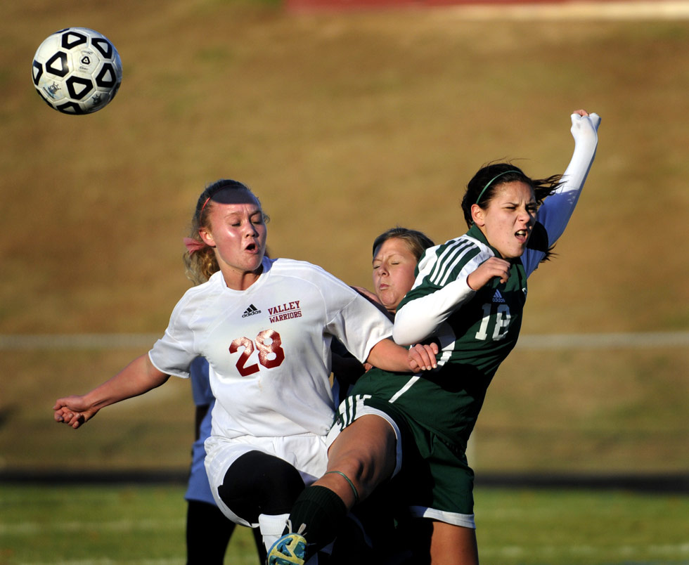 Caitlyn Kelly of Valley Regional (28) battles for control with Enfield's Christina Leonardo (18) in the first half.