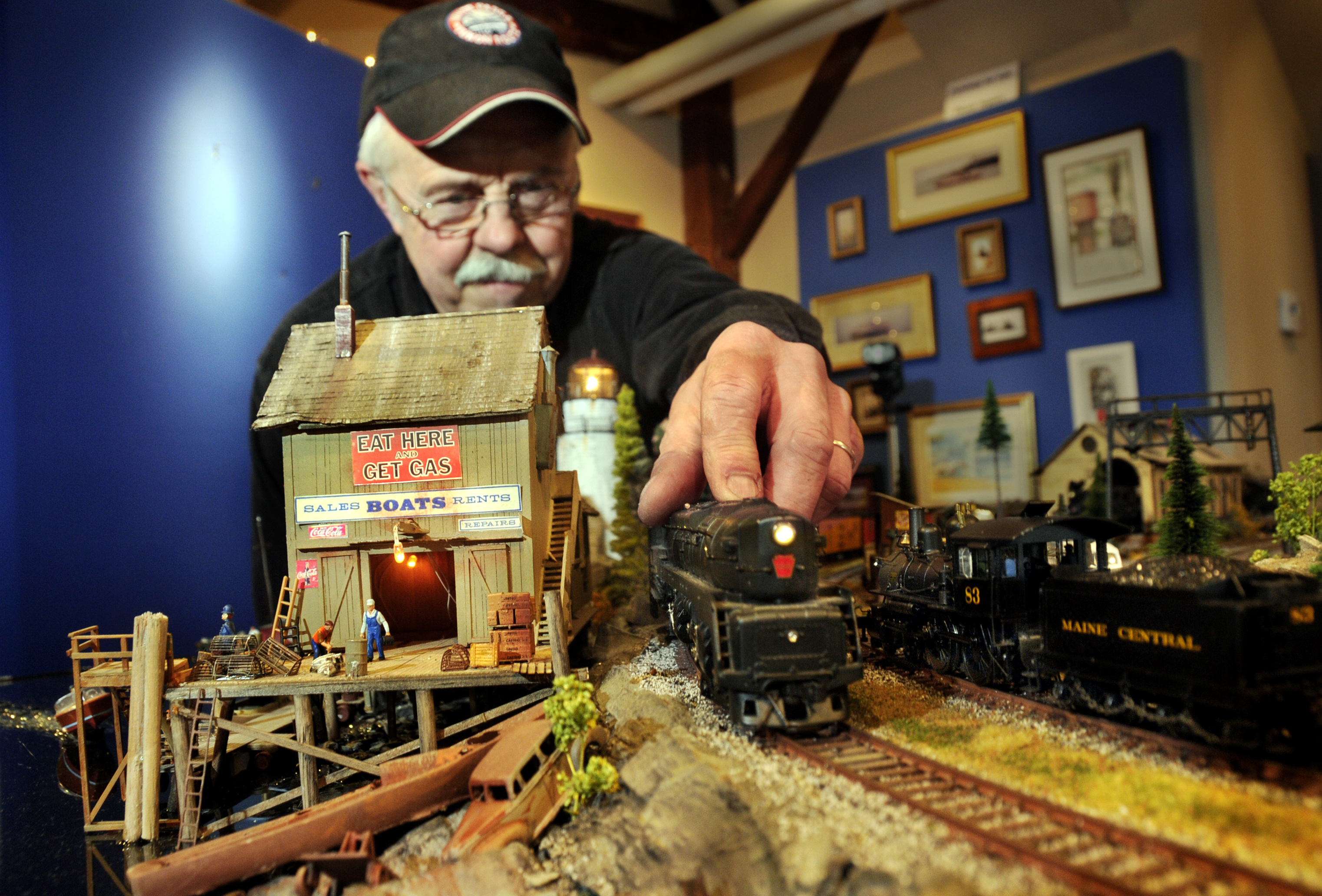 Steven Cryan, a local maritime and railroad artist and master model train builder has spent months putting together his latest creation on the 3rd floor of the museum.