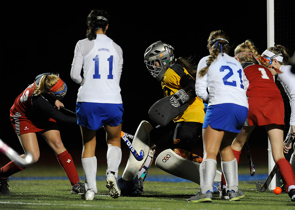 Kiernan Henderson (L) got the scoring started for Conard at the 23:14 mark of the first half as she slips the ball past Hall goalie Kathleen Keegand Wednesday night.