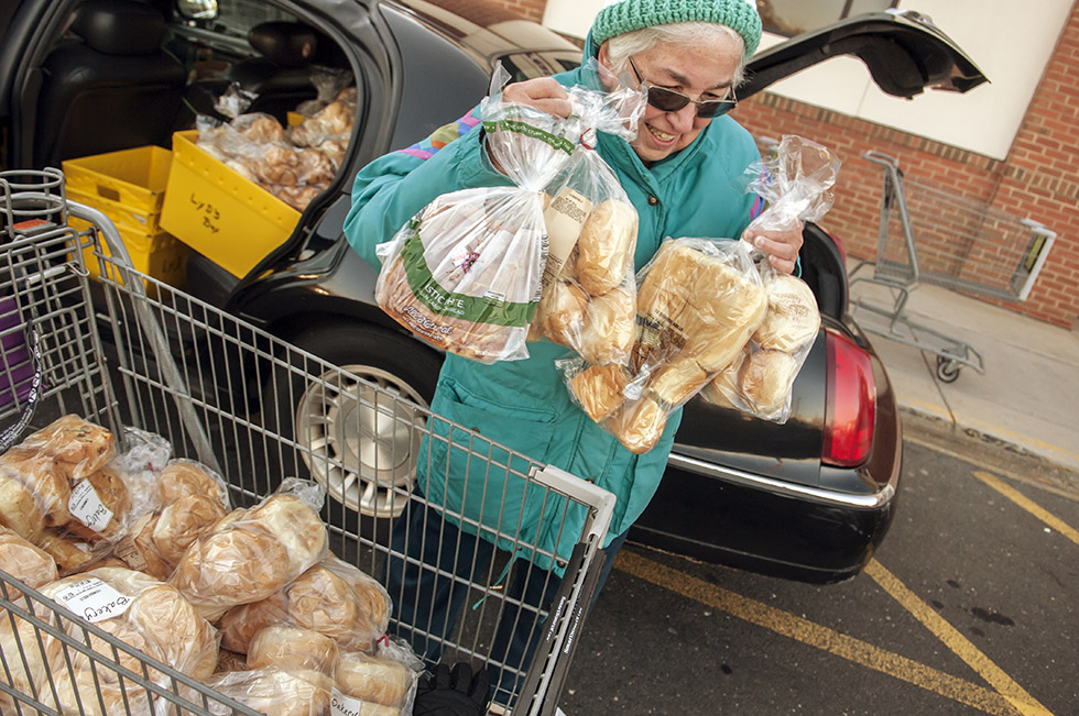 """2013.11.29 - South Windsor, CT - """"Talk about recycling,"""" says Lydia Lewis, 84, of East Hartford, who every Friday and Saturday morning loads her car with shopping carts full of food deemed too old to be sold but okay to eat from a Stop and Shop in South Windsor. The food, which would otherwise be thrown away, is then delivered by Lewis to Wesley Memorial United Methodist Church and St. John's Episcopal Church in East Hartford where the food is then """"distributed to the needy."""" """"I tell everybody I'm a food-aholic,"""" says Lewis, """"I can't see this going to waste.""""  Photograph by Mark Mirko   mmirko@courant.com"""