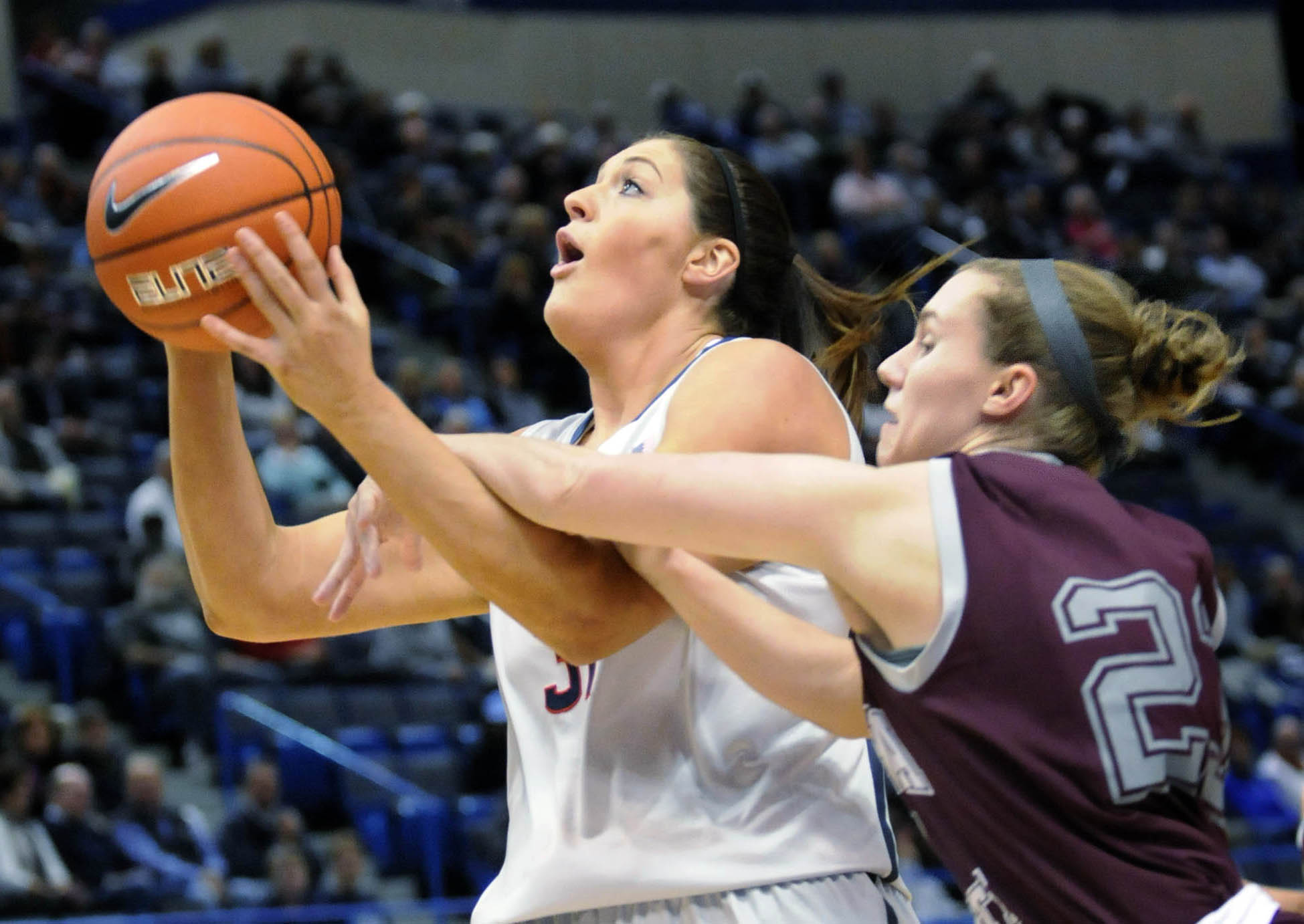 HARTFORD 11/05/13 UConn's Stefanie Dolson (31) is fouled by Philadelphia's Monica Schacker (23) in the first half in an exhibition game at the XL Center in Hartford Tuesday night.  CLOE POISSON|cpoisson@courant.com