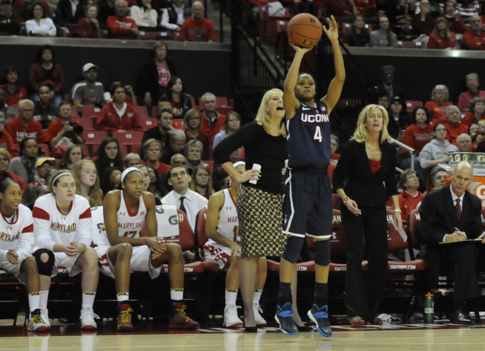With two players out due to injuries, each player needed to step up for their game against eight ranked Maryland. Here, UConn's sophomore guard, Moriah Jefferson, 4, shoots as Maryland Terrapins head coach Brenda Frese shouts in her ear  during the first half.