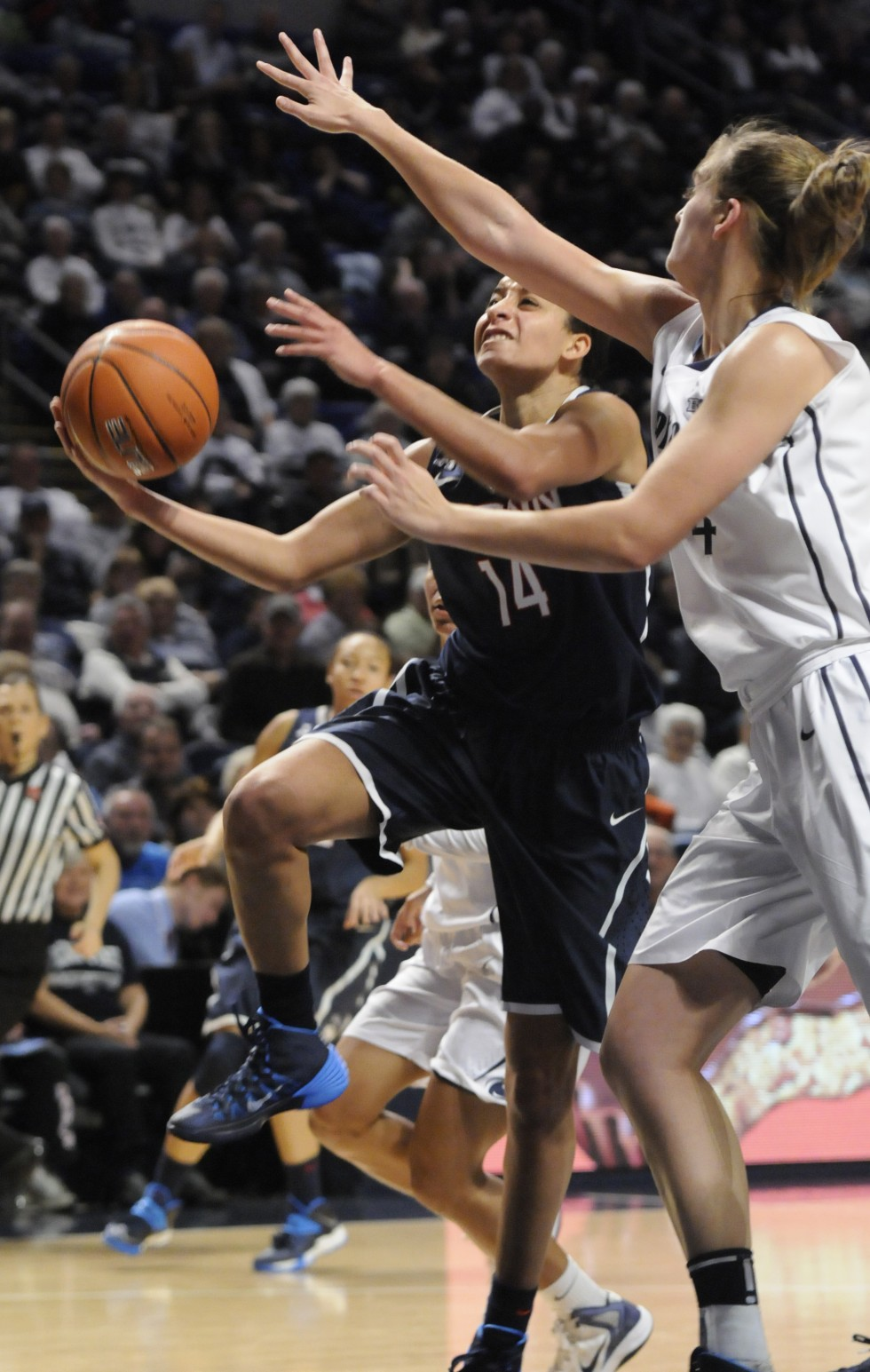 Bria Hartley dries to the basket over Penn State University junior forward/center, Tori Waldner. Hartley led the game in scoring with 29 points.
