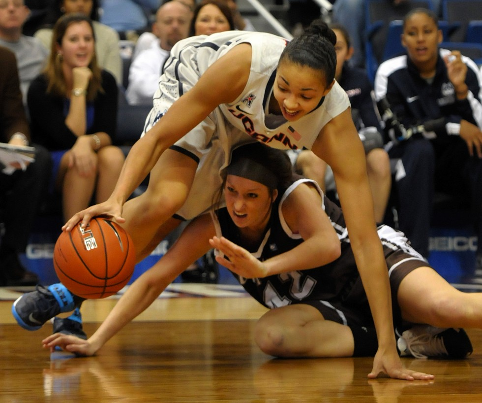 Connecticut Huskies center Kiah Stokes, 41, battles St. Bonaventure Bonnies forward Katie Healy, 42, for a loose ball  in the second half.