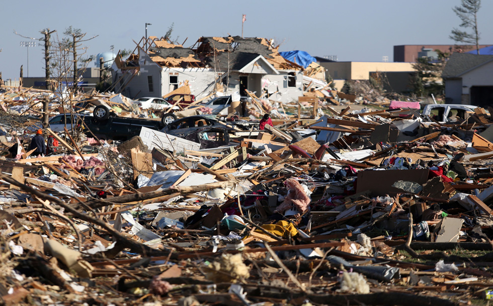Residents survey the the destruction caused by the E-F4 tornado that devastated large parts of Washington, Illinois on Sunday, November 17th. Tasos Katopodis/Getty Images)