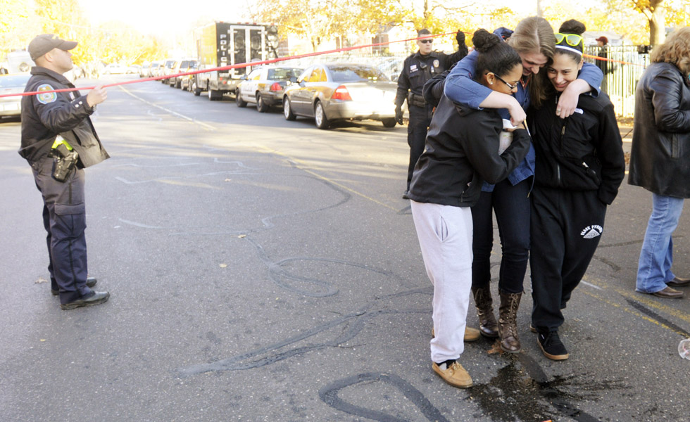 "Three woman, who refused to be identified, enbraced as they left campus after students were allowed to leave Monday afternoon. Three ""people of interest"" were in custody after a report of a man with a sword and-or a gun put the Central Connecticut State University campus into a lockdown that spanned more than three hours Monday."