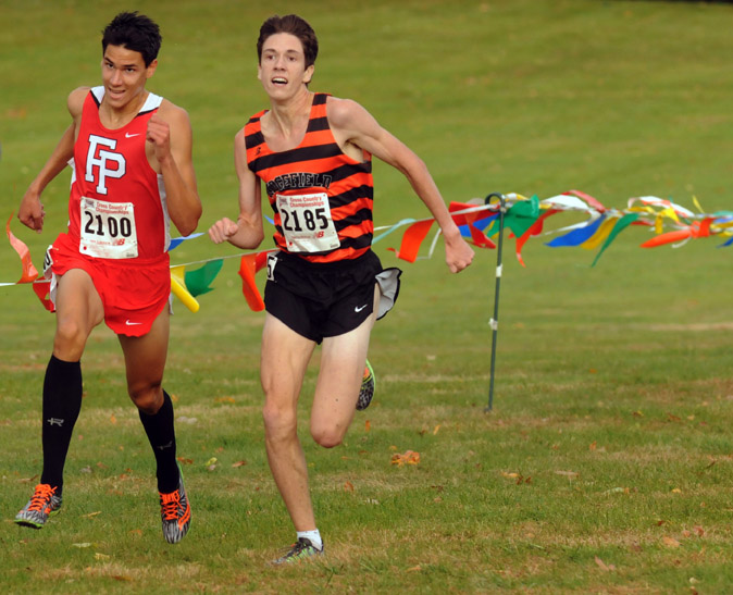 Christian Alvarado, of Fairfield Prep, left, and Trevor Hopper, of #Ridgefield, right,  dash neck and neck to the finish line at State Open cross country meet at Wickham Park Friday. Alvarado won it.
