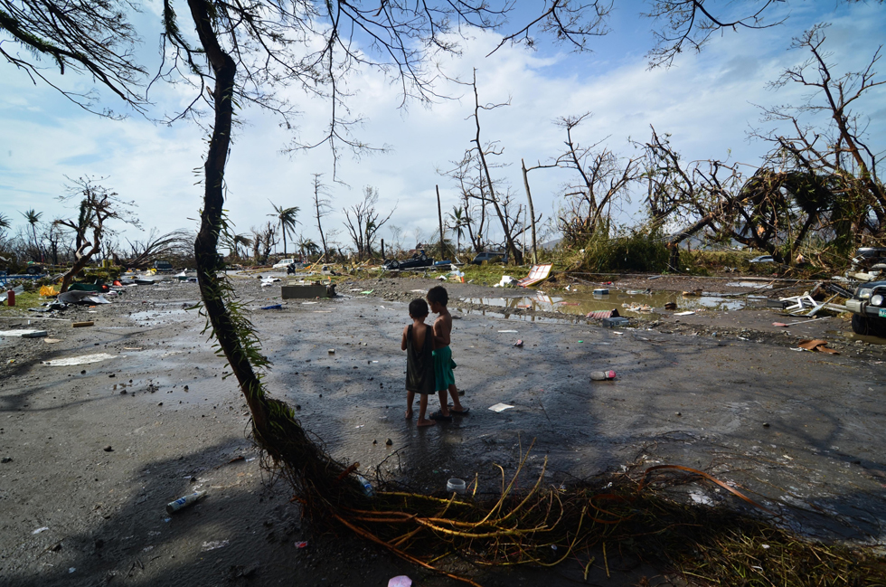 Two young boys survey the devastation in the wake of Typhoon Haiyan after struck the Philippines, November 10, 2013, Tacloban,Philippines.
