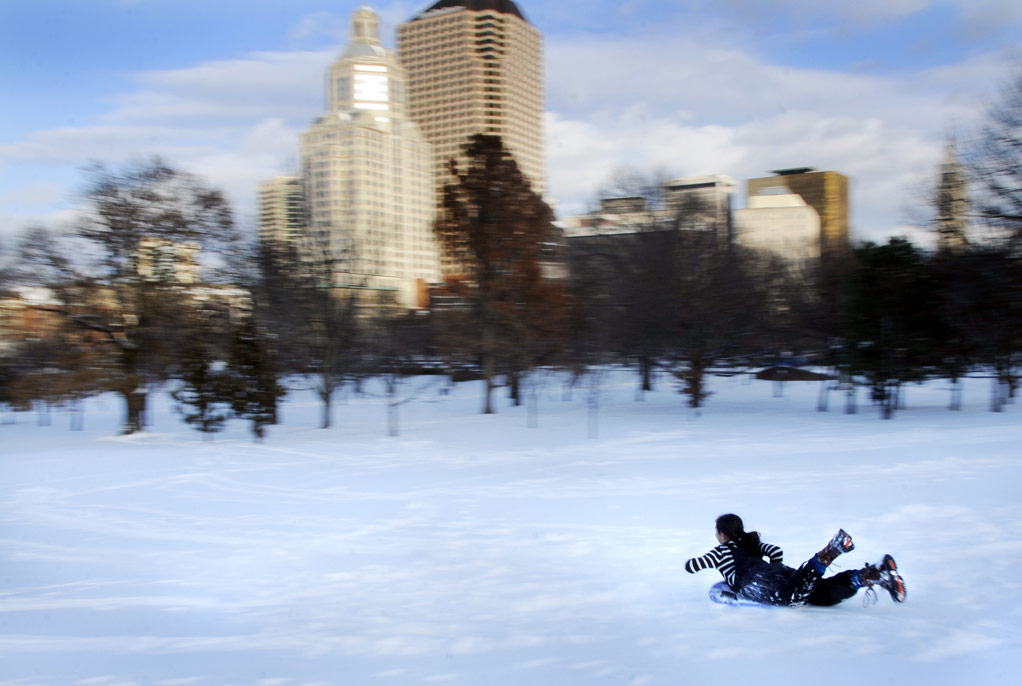 Mary Fattouh, 12, of Hartford slides down the Bushnell Park sledding hill near the State Capitol on freshly fallen snow Sunday afternoon.