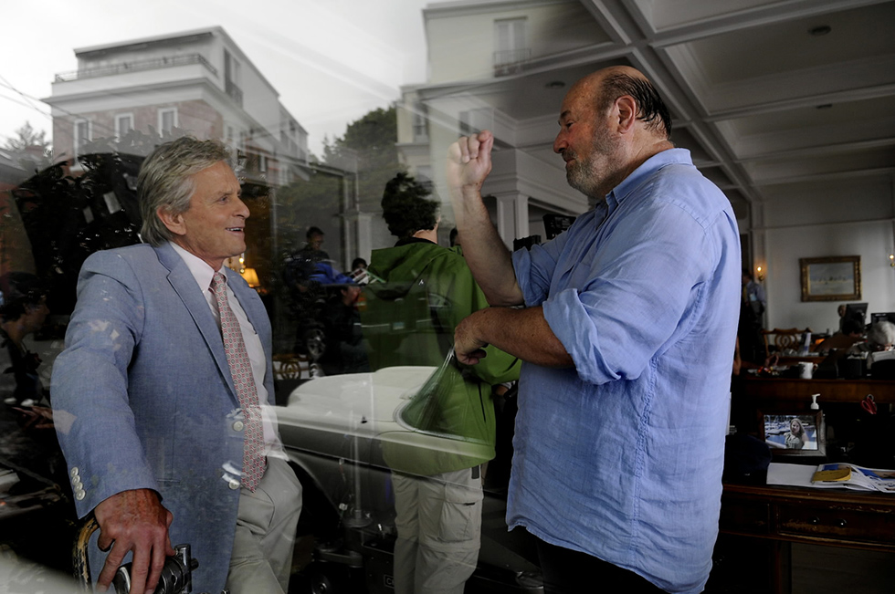 """Southport, CT  6/13/13  Michael Douglas talks with director Rob Reiner on the set of the movie """"And So It Goes"""" which was being filmed inside Nicholas Fingelly Real Estate in the Southport section of Fairfield. Diane Keaton and Frances Sternhagen are also in the movie, Keaton was not on set today.  Photo by JOHN WOIKE 