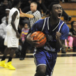 East Catholic Boys Hoop defeat East Hartford