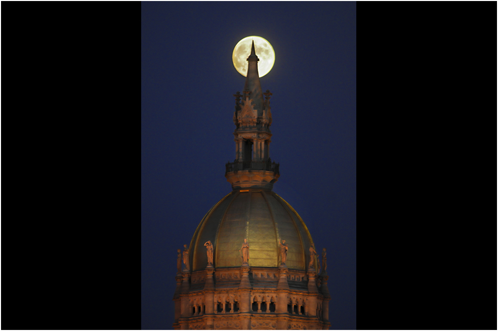 HARTFORD 10/17/13 The Hunter's moon rings the spire on the state Capitol dome.