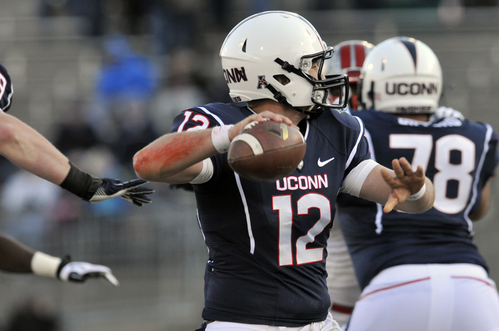 2013.11.30 - East Hartford, CT - His arm marked red with abrasions, UConn quarterback Casey Cochran gets set to pass during UConn's 28-17 defeat of Rutgers. Cochran completed 25 of 33 passes for a net 311 yards. Photograph by Mark Mirko | mmirko@courant.com