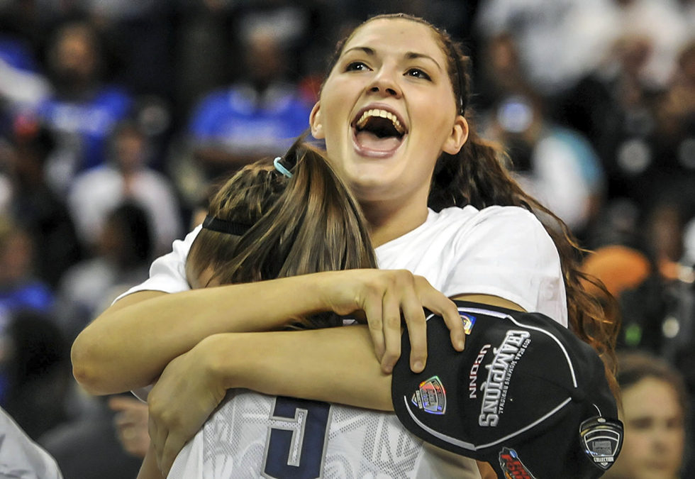 BRIDGEPORT 04/01/13 Connecticut Huskies center Stefanie Dolson (31) hugs teammate Caroline Doty (5) after UConn defeated Kentucky, 83-53 on their Elite Eight game at the Webster Bank Arena.  UConn advances to the Final Four.  CLOE POISSON|cpoisson@courant.com