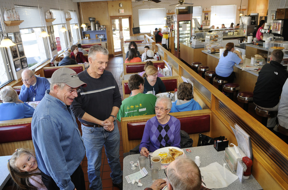 Ron and Rod Mortensen, twin brothers and owners of Mortensen's Ice Cream & Restaurant, make the rounds on the last day of the year to say goodbye to their loyal customers.