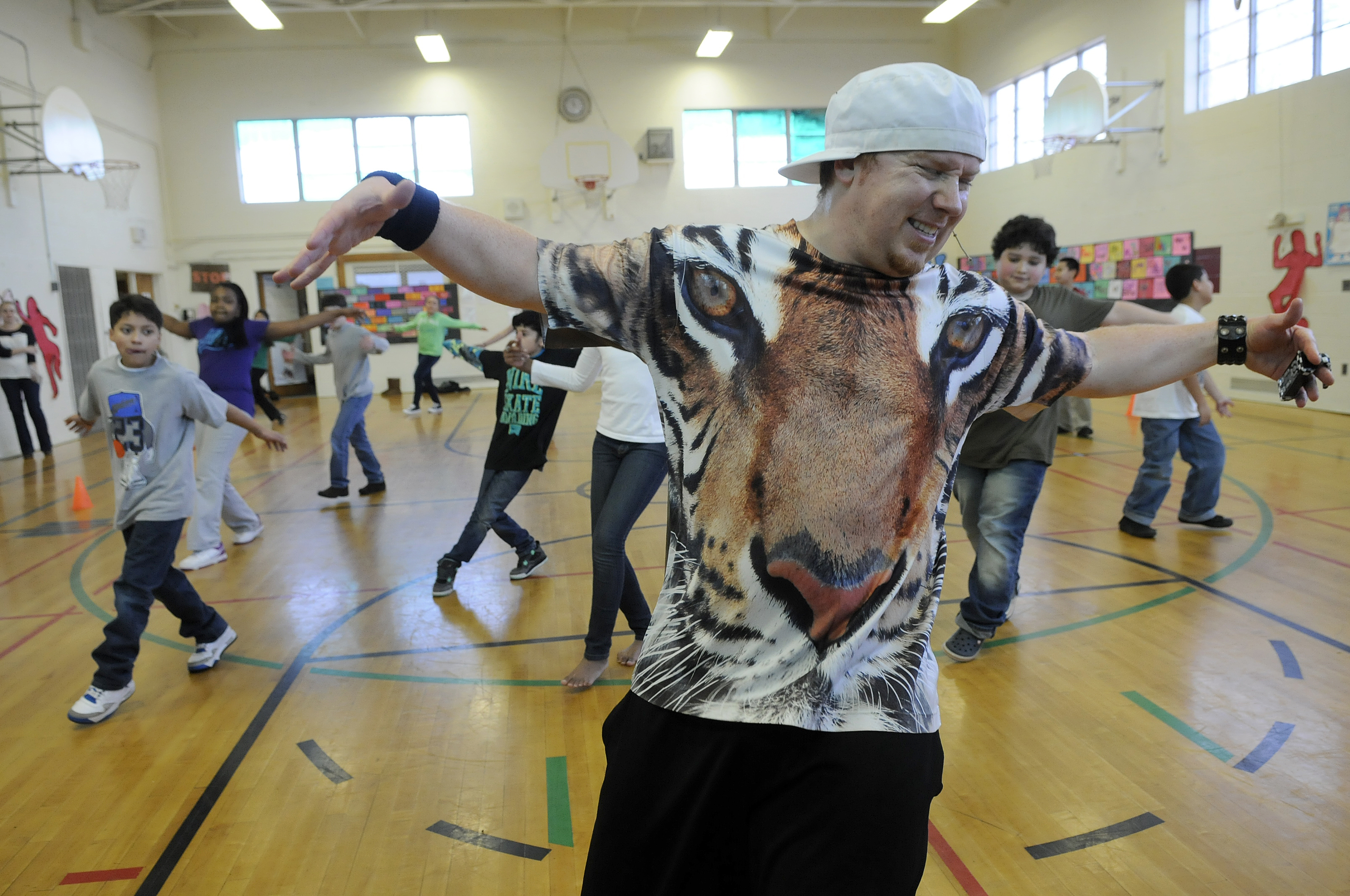 WEST HARTFORD 01/15/14 Austin Dailey, of Durham, CEO of Red Supreme Productions, teaches a hip-hop step called top rock to fifth-graders at Charter Oak International Academy Wednesday.  CLOE POISSON|cpoisson@courant.com