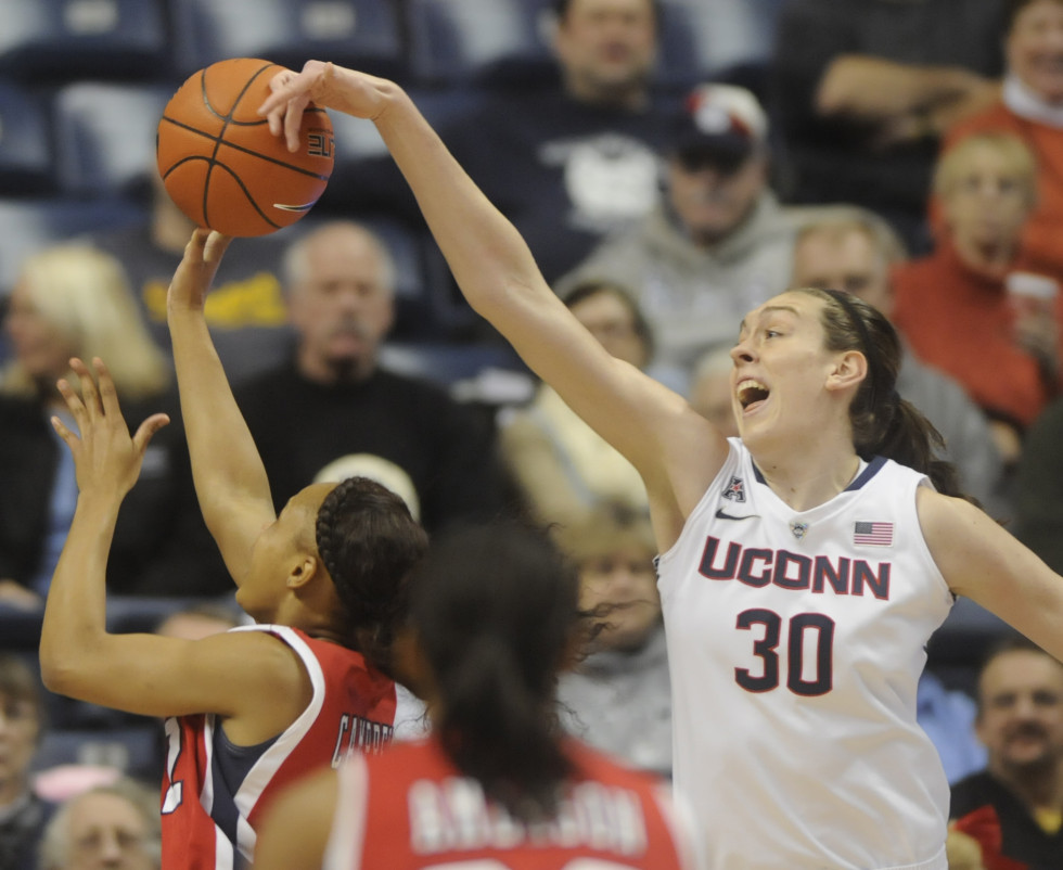 University of Connecticut Huskies forward Breanna Stewart, 30, blocks the shot of University of Houston Cougars forward Destini Texada, 12,  during the first half.