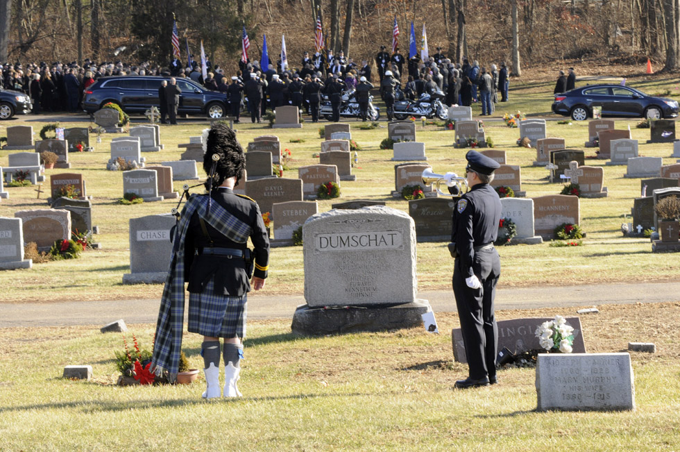 "Taps is played to be followed by ""Amazing Grace"" on bagpipes at Wapping Cemetery following the memorial service for a longtime South Windsor police officer, Lt. Richard Bond."