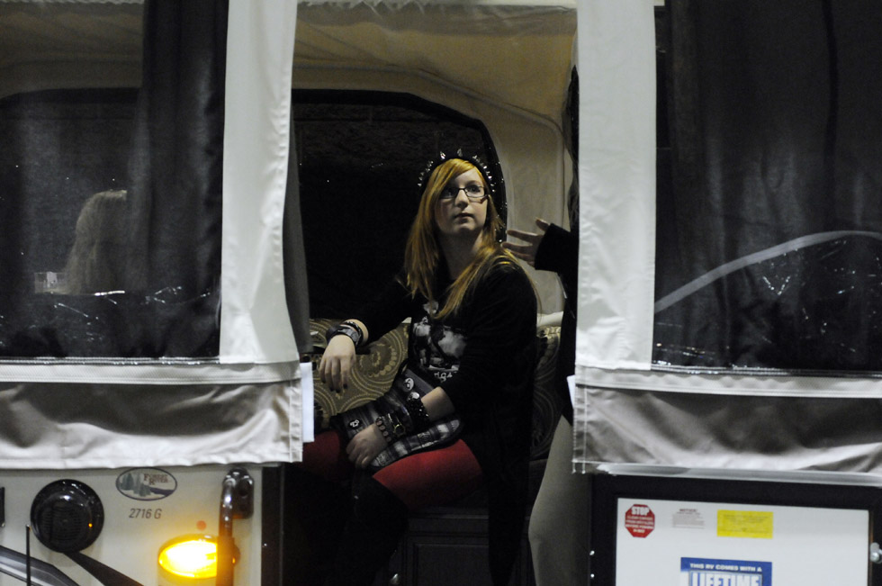 Jessica Romaniello, 13, of Waterbury, at center, listens to a presentation by a representative of Long View RV Superstores aboard a new pop-up camper on display during the final day of The Northeast Recreational Vehicle & Camping Show at the Connecticut Convention Center in Hartford