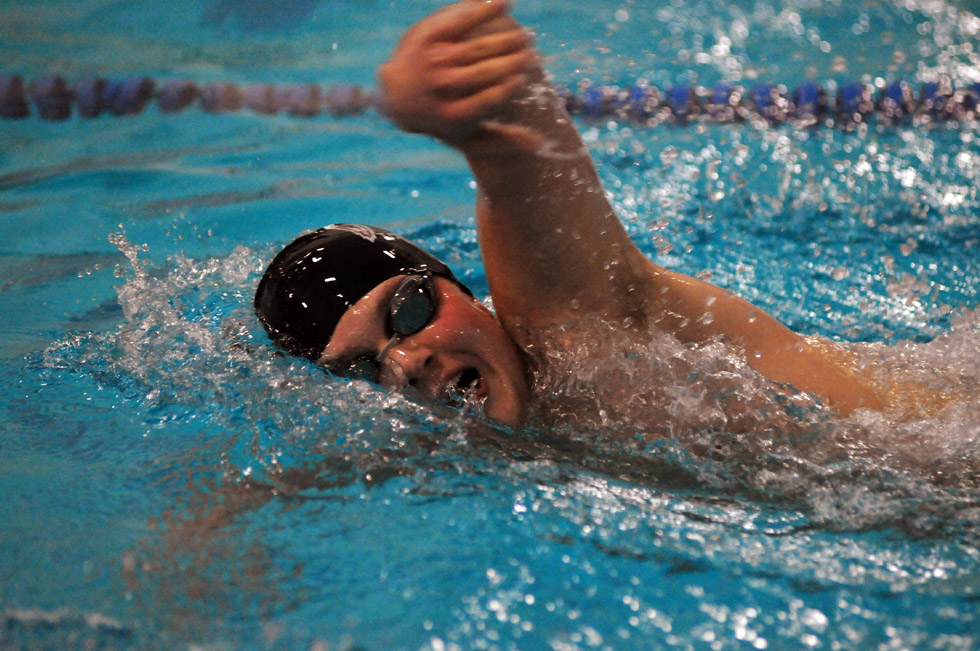 Farmington's Max Vitkin swims to first place in the Boys 500 Yard Freestyle just ahead of Robert Davis of Glastonbury at the Farmington at Glastonbury swim meet Wednesday.