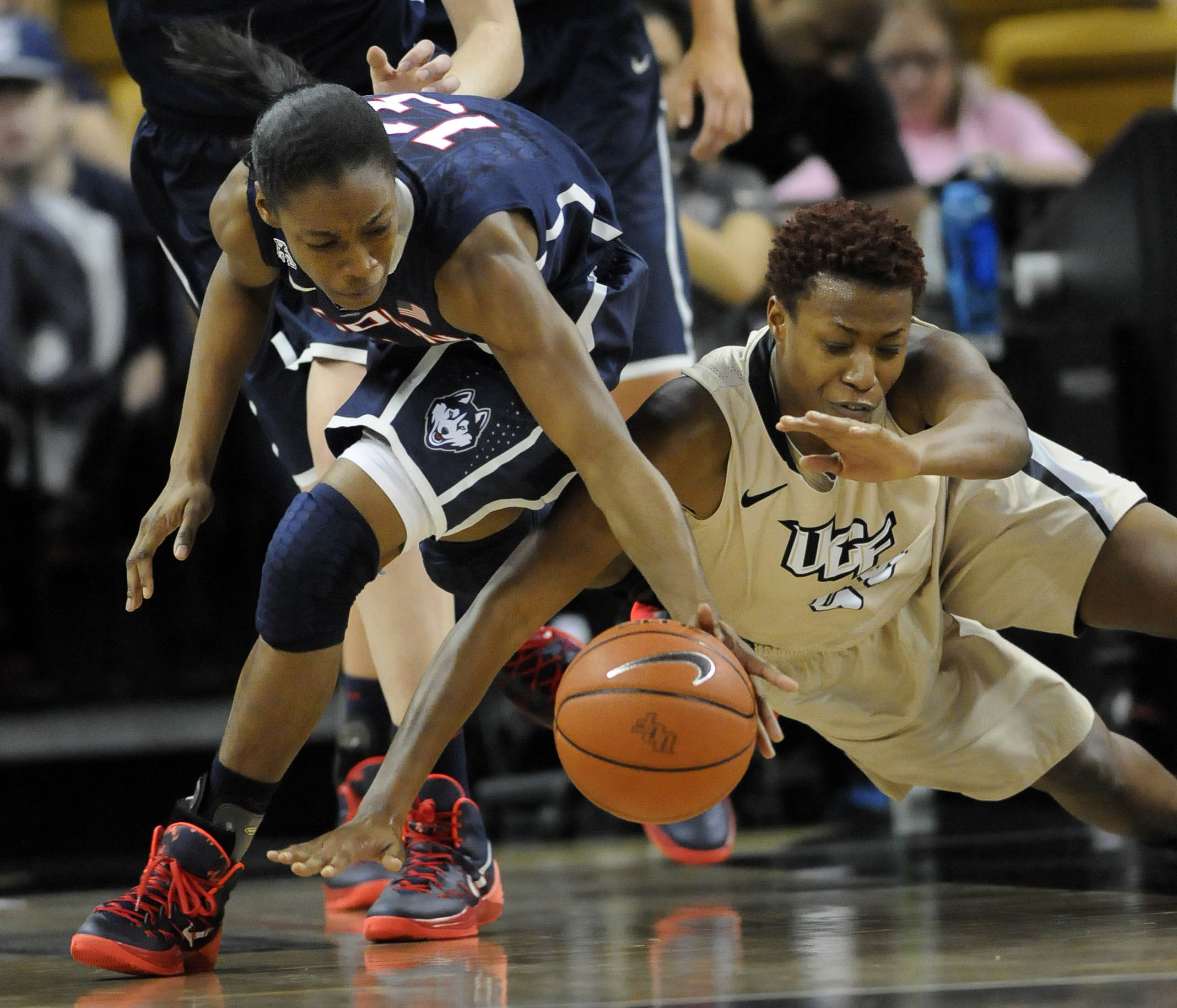 ORLANDO, FL 01/01/14 UConn Huskies guard Brianna Banks (13) grabs a loose ball from UCF Knights forward/center Erika Jones (55) in the first half against UCF at UCF Arena Wednesday.  UConn beat the Knights, 77-49. CLOE POISSON|cpoisson@couant.com