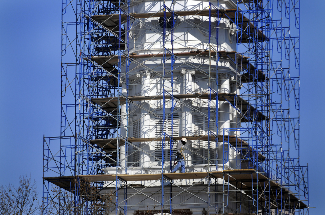 The scaffolding takes shape on the iconic Main Street church Monday.