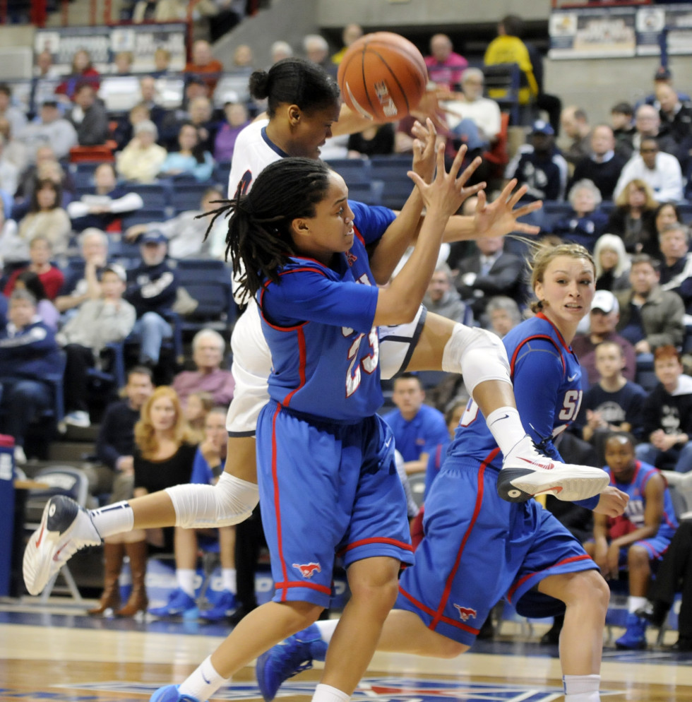 University of Connecticut Huskies guard Moriah Jefferson, 4, is fouled on her way to the basket as Southern Methodist University guard Keena Mays, 23, left, and Southern Methodist University guard Korina Baker, 10, try to stop the break away during the first half.