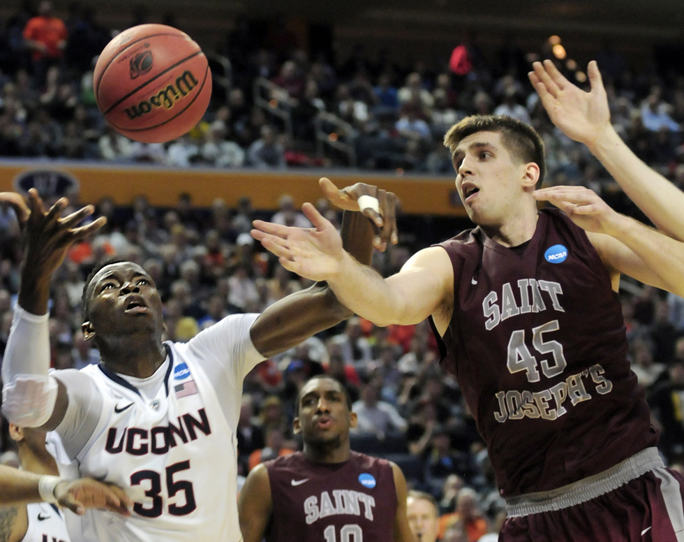 With seconds left, this rebound, shot and foul by Amida Brimah tied the game in regulation. At right is St. Joe's Halil Kanacevic.