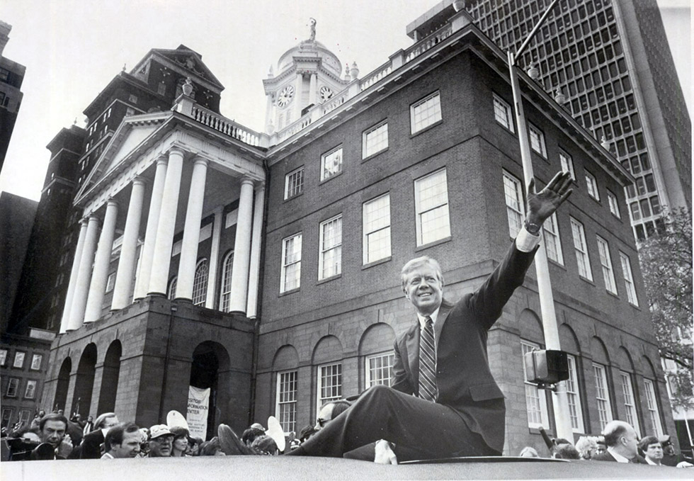 19.16.1980 - Hartford, CT - President Jimmy Carter, from the roof of his limo, waves to fans outside the Old State House in Hartford. MICHAEL McANDREWS | The Hartford Courant