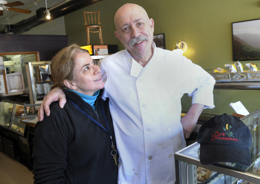 Owner Chef Rob Chiovoloni, of Café Beauregard, stands with his wife, Alice Bruno, behind the counter of his New Britain café. Behind them, sitting on top of soda refrigerator, is the chair that President Barack Obama sat in yesterday while eating at their New Britain sandwich shop.