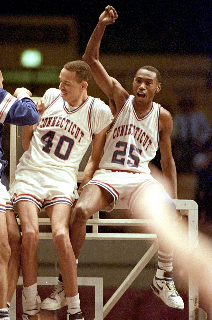 3/30/1988- NIT CHAMPIONS - UConn players #40 Jeff King (c) and #25 Phil Gamble (r / with arm raised ) climb the basket after defeating Ohio State University in the NIT.