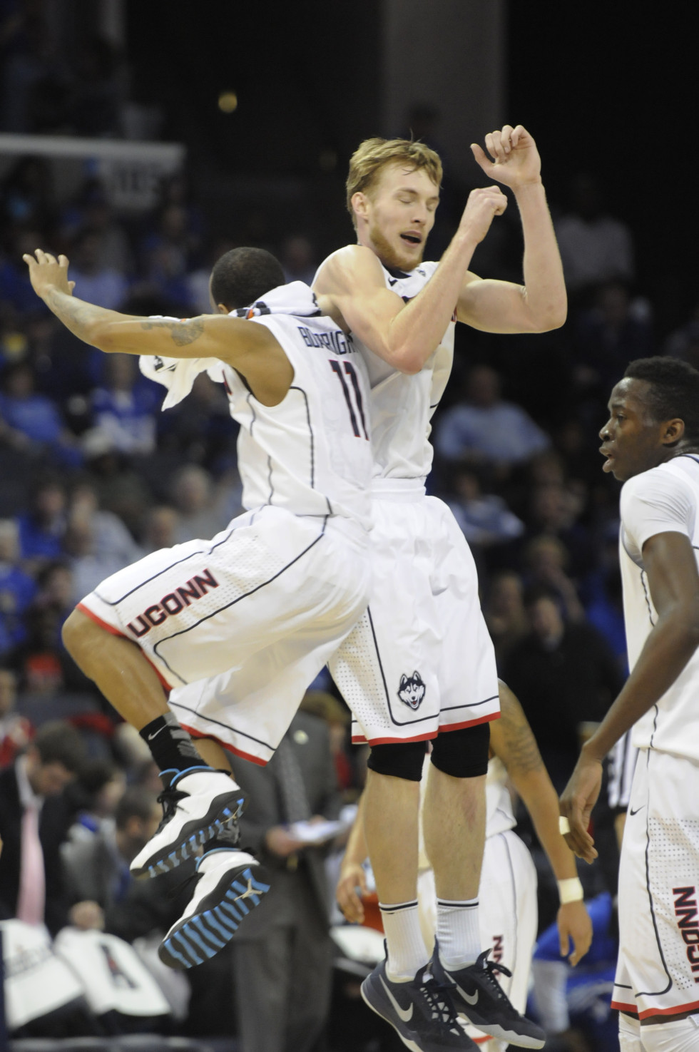University of Connecticut Huskies guard/forward Niels Giffey, 5, and University of Connecticut Huskies guard Ryan Boatright, 11, celebrate during a break in the action after Giffey hit a three point shot during the second period.