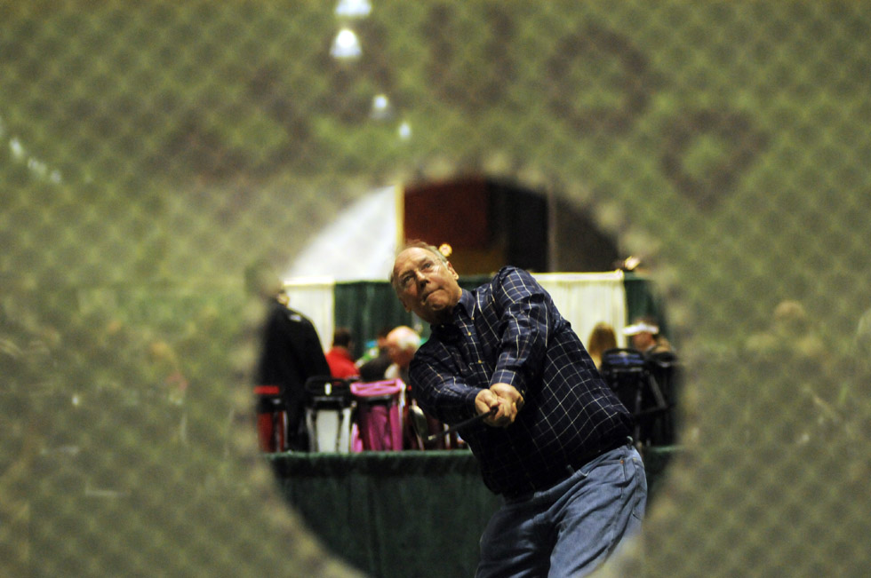 "Bob Bills of Granby shoots for a hole in one in the Short Game attraction at the Connecticut Golf Show at the Connecticut Convention Center in Hartford Friday afternoon. ""I love to golf,"" he said. ""I can hardly wait for the snow to melt."""
