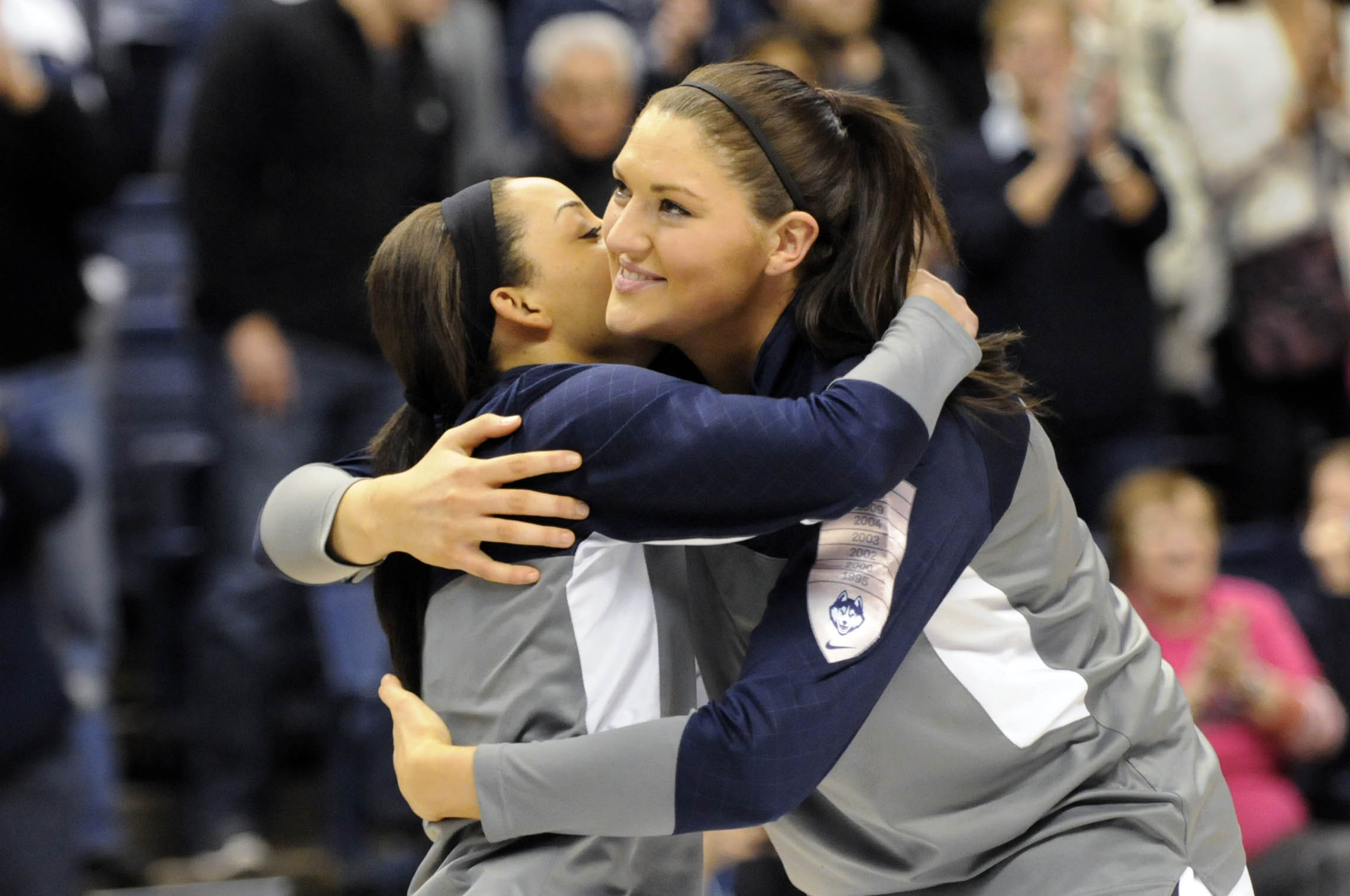 STORRS 03/01/14 UConn seniors Bria Hartley and Stefanie Dolson hug after they were honored at Senior Day ceremonies at Gampel Pavilion before their game against Rutgers Saturday. CLOE POISSON|cpoisson@courant.com