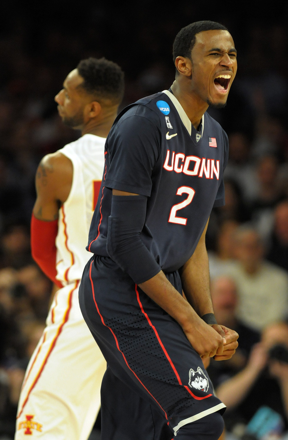 UConn Huskies forward DeAndre Daniels, 2, reacts after hitting a three-point shot as Iowa State Cyclones guard DeAndre Kane, 50, looks away during the second half.